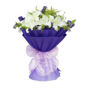 鲜花/海空之恋11枝白百合: 11枝香水百合。  [包 装]:紫色瓦楞纸圆
