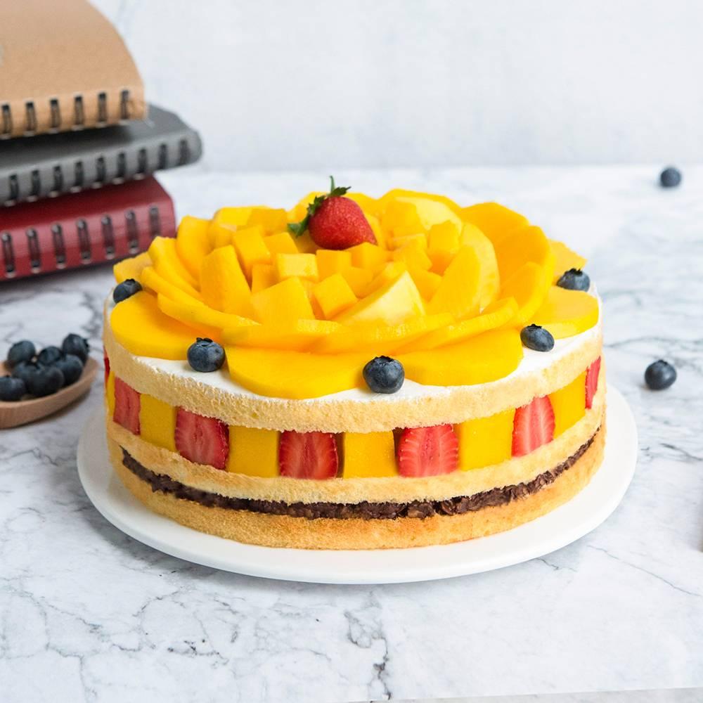 蛋糕/加冕为王:鲜奶蛋糕胚搭配水果夹层,芒果蓝莓铺面 祝 愿:在自