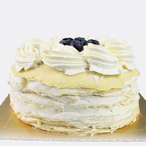 蛋糕/榴莲飘香:圆形榴莲蛋糕,榴莲新鲜果肉夹层,层层蛋饼,奶油花、蓝